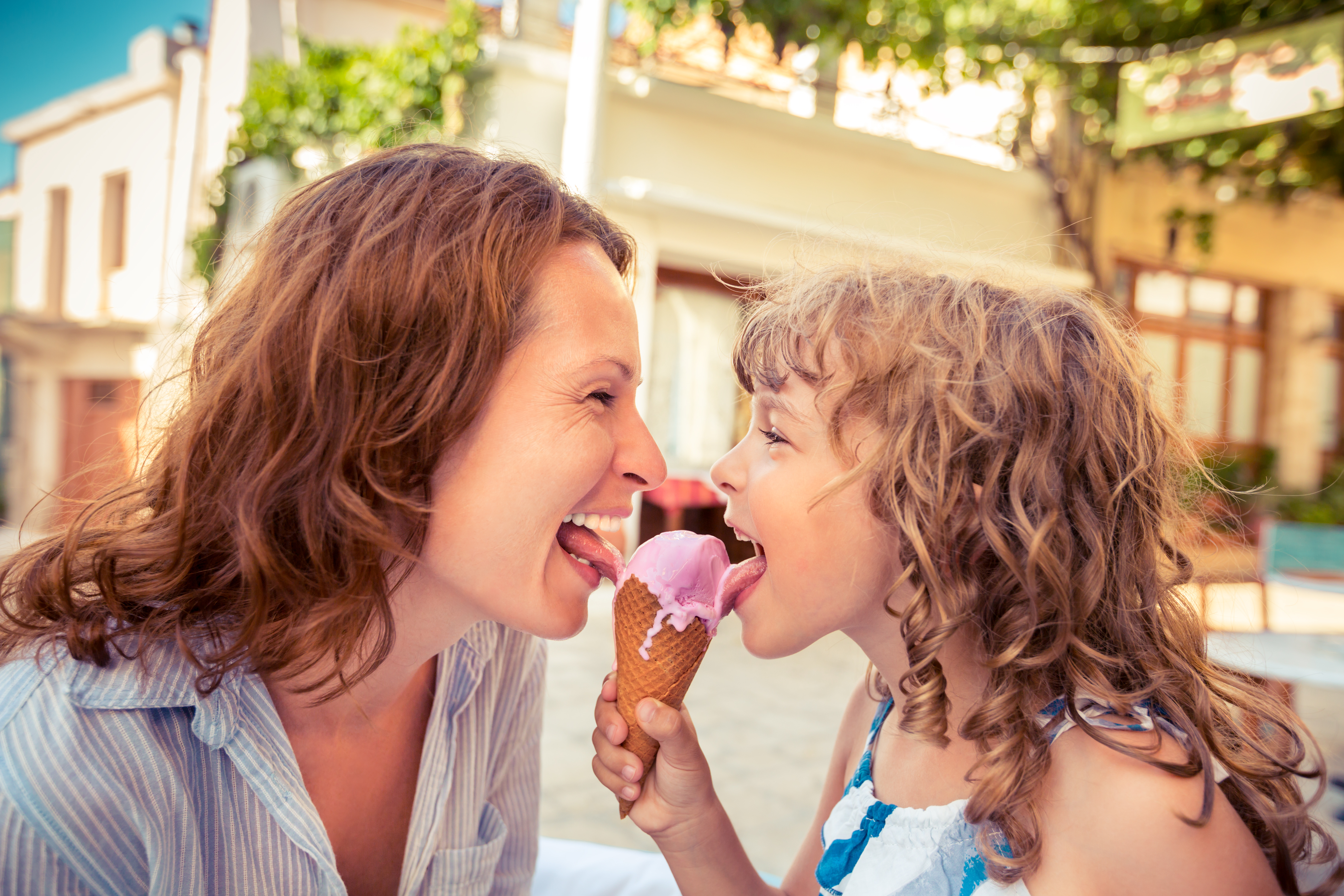 Child and mother eating ice cream together