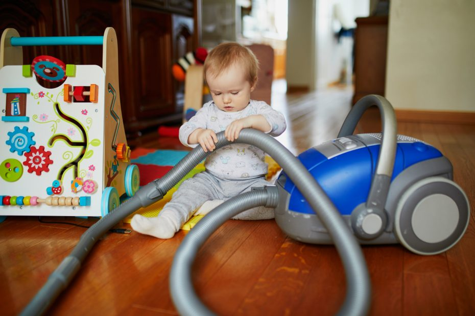 Baby playing with vacuum