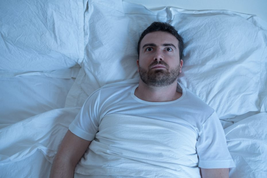 father lying in bed wide awake